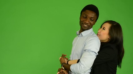Happy multicultural couple in love smile- green screen