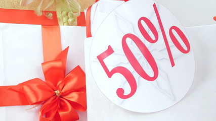 Christmas  gift boxes with fifty percent sale discount sign