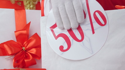 fifty percent sale discount sign on Christmas gift boxes