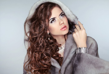 Fashion beautiful woman posing in fur coat. Winter Girl Model in