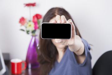 blue shirt woman showing screen smartphone