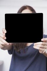 blue shirt woman showing screen tablet