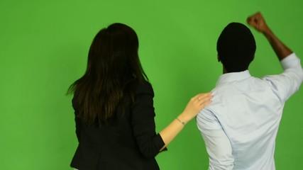 happy multicultural couple rejoice - green screen studio
