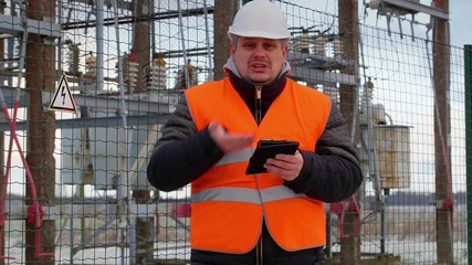 Angry Electrical Engineer with tablet PC in substation
