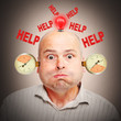 Stressed and overworked businessman under pressure.