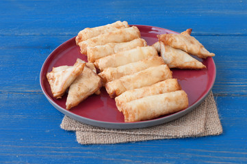 cheese filled rolls and meat stuffed triangle wraps