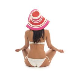 Woman meditation at the beach