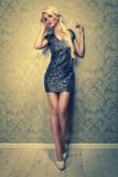 Fototapety sexy blonde woman in a silver mini dress