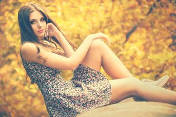 beautiful girl sitting on a tube