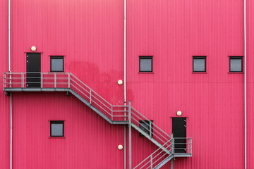 Fire escape on a red facade