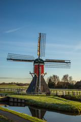Mill in a typical Dutch landscape