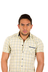 young handsome serious hispanic man with a frown