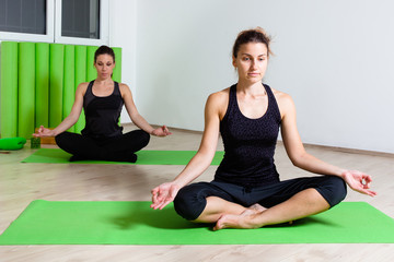 two girls in lotus position