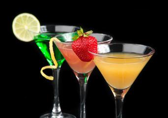 Three cocktails cosmopolitan cocktails decorated with citrus lem