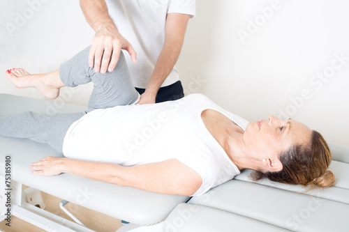 Chiropractic care with elderly woman - 75385980