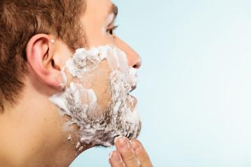 Man shaving beard face profile