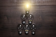 glowing bulb leadership concept on wooden background