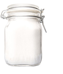 Granulated sugar in glass jar container