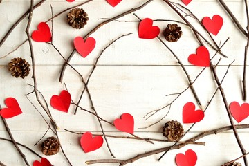 Red heart paper cut out with pine cone