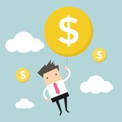 Businessman hanging money balloon