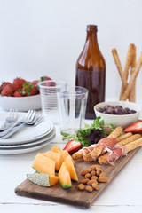 Simple party snack board with olives and beer