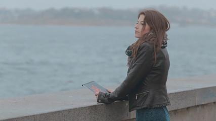 Feminine girl standing on the seafront promenade,  the seagull
