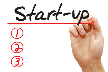 Hand writing Start-up List with red marker, business concept
