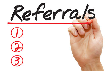 Hand writing Referrals List with red marker, business concept