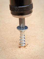 Galvanized screw fastened in wood