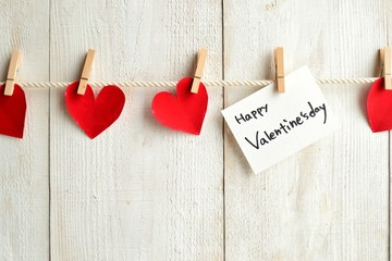 Valentines day message card and heart with clothes pin