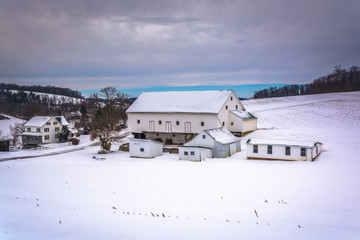 Barn in a snow covered farm field in rural York County, Pennsylv