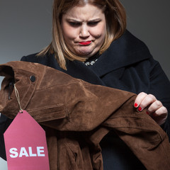Suspicious woman shopping on sales