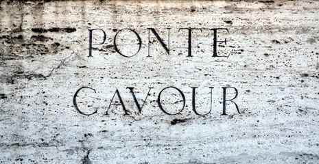 Stone plaque on Ponte Cavour in Rome, Italy