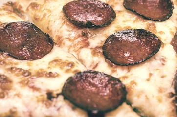 Retro Photo Of Pizza With Pepperoni Salami Closeup