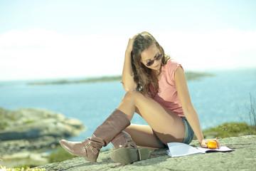 Summer life girl leisure reading at seaside