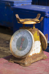 Rusting metal scales in use at a fish market Thailand