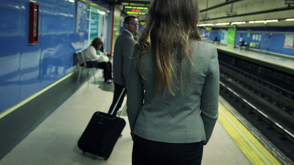 Young businesspeople waiting for metro in platform