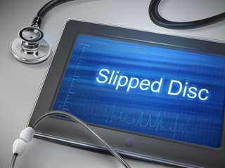 slipped disc words displayed on tablet