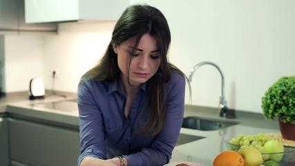 Pensive, thoughtful businesswoman drinking tea in kitchen