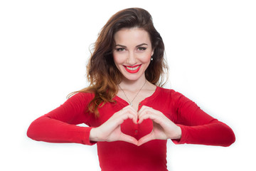 lady in red showing heart shape with her fingers