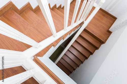 wooden staircase made from laminate wood in white modern house - 75397395