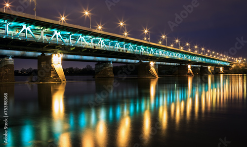 Zdjęcia na płótnie, fototapety, obrazy : Highlighted bridge at night and reflected in the water.Bridge Gd