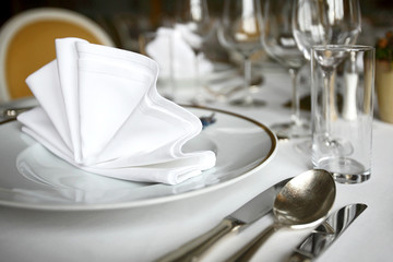 Fine dining table set up restaurant, plate and glasses