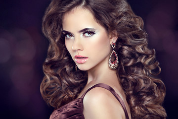 Wavy hair. Attractive girl with makeup. Jewelry Earring. Express