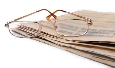 Glasses and newspapers, isolated on white