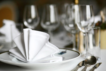 Plate and wine glasses set up at restaurant, cutlery