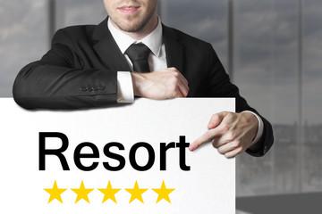 businessman pointing on sign resort five stars