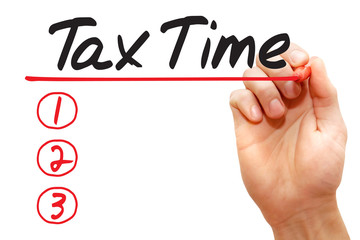 Hand writing Tax Time List with red marker, business concept