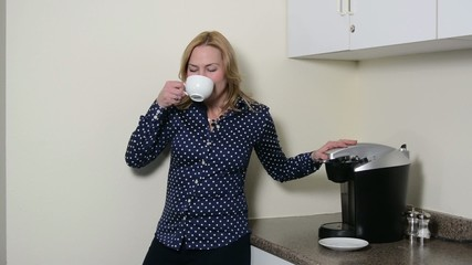A woman enjoying a sip of coffee