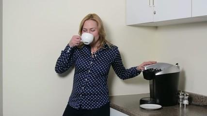 A woman enjoying a sip of coffee